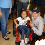 Diego with Wheelchair Recipient in Ecuador